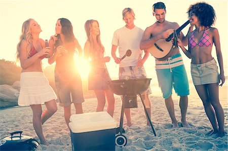 friend - Friends cooking barbecue on the beach Stock Photo - Premium Royalty-Free, Code: 6109-06781572