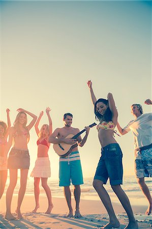 Friends dancing and having fun on the beach Stock Photo - Premium Royalty-Free, Code: 6109-06781582