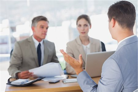 Serious business people listening to applicant Stock Photo - Premium Royalty-Free, Code: 6109-06781519