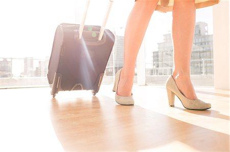 Businesswoman walking Stock Photo - Premium Royalty-Free, Code: 6109-06781531