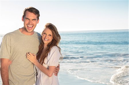 Pretty couple standing and embracing on the beach Stock Photo - Premium Royalty-Free, Code: 6109-06781654