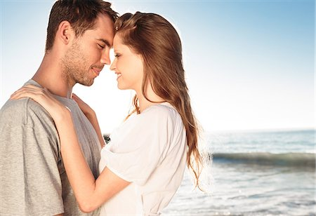 Romantic couple relaxing and embracing on the beach Stock Photo - Premium Royalty-Free, Code: 6109-06781667