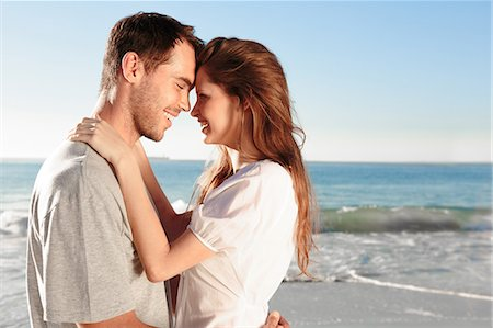 Attractive couple relaxing on the beach Stock Photo - Premium Royalty-Free, Code: 6109-06781665