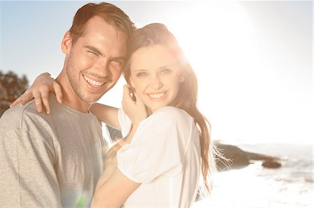 Cheerful couple embracing on the beach Stock Photo - Premium Royalty-Free, Code: 6109-06781673