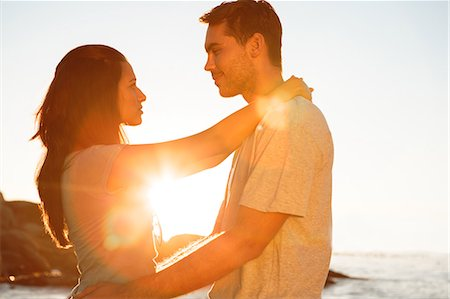 Young couple embracing each other on the beach Stock Photo - Premium Royalty-Free, Code: 6109-06781689