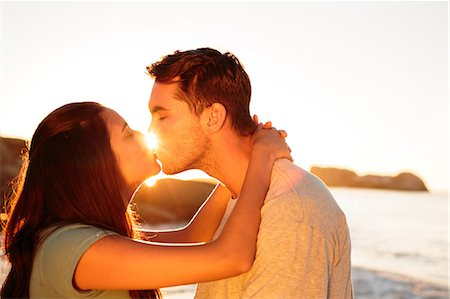 Couple embracing and kissing each other on the beach Stock Photo - Premium Royalty-Free, Code: 6109-06781692