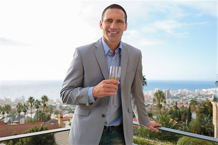 dark hair - Attractive man holding glass of champagne Stock Photo - Premium Royalty-Free, Code: 6109-06781614