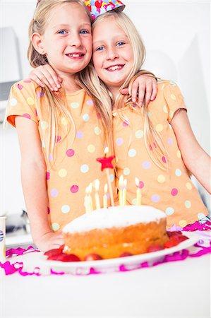 Cute twins celebrating their brithday Stock Photo - Premium Royalty-Free, Code: 6109-06781755