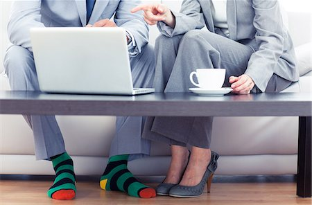 Business people sitting on a couch Stock Photo - Premium Royalty-Free, Code: 6109-06781758