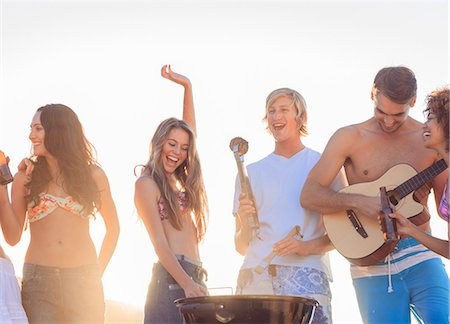 Group of friends having fun together on the beach Stock Photo - Premium Royalty-Free, Code: 6109-06781772