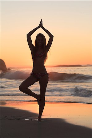 Sunset with woman doing yoga Stock Photo - Premium Royalty-Free, Code: 6109-06781795