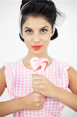 Young pinup holding a lollipop Stock Photo - Premium Royalty-Free, Code: 6109-06781853