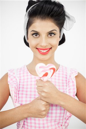 picture of a red lollipop - Pretty young pinup holding a lollipop Stock Photo - Premium Royalty-Free, Code: 6109-06781851