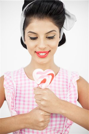 picture of a red lollipop - Sexy young pinup holding a lollipop Stock Photo - Premium Royalty-Free, Code: 6109-06781852