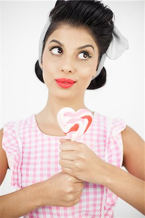 Sexy pinup holding a lollipop Stock Photo - Premium Royalty-Free, Code: 6109-06781854