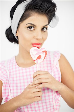 picture of a red lollipop - Wonderful pinup holding a lollipop Stock Photo - Premium Royalty-Free, Code: 6109-06781855