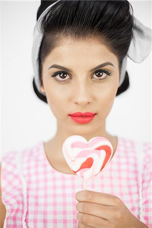 picture of a red lollipop - Glamorous pinup holding a lollipop Stock Photo - Premium Royalty-Free, Code: 6109-06781856