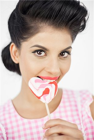 picture of a red lollipop - Seductive young pinup biting a lollipop Stock Photo - Premium Royalty-Free, Code: 6109-06781859