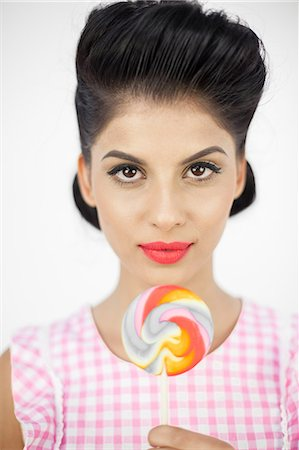 picture of a red lollipop - Pretty young pinup with a lollipop Stock Photo - Premium Royalty-Free, Code: 6109-06781861