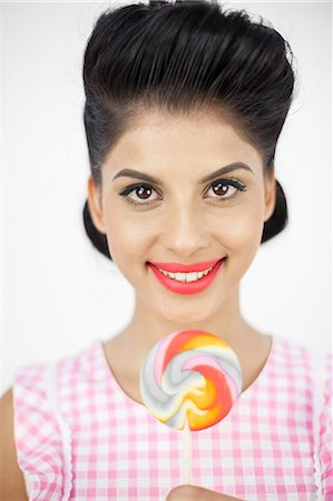 Cheerful young pinup with a lollipop Stock Photo - Premium Royalty-Free, Code: 6109-06781862