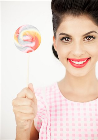 picture of a red lollipop - Cute young pinup showing her lollipop Stock Photo - Premium Royalty-Free, Code: 6109-06781865