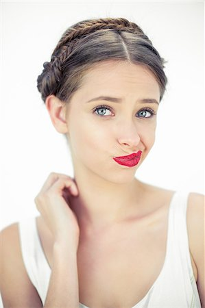 seductive - Attractive teen with red lips posing Stock Photo - Premium Royalty-Free, Code: 6109-06781874