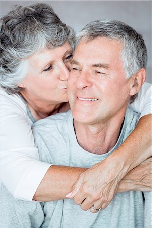 Cheerful mature woman kissing her husband Stock Photo - Premium Royalty-Free, Code: 6109-06781887
