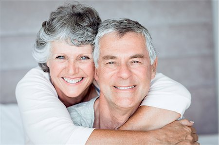 Mature woman embracing her husband Stock Photo - Premium Royalty-Free, Code: 6109-06781885