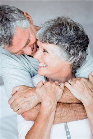 Mature man embracing his wife Stock Photo - Premium Royalty-Free, Code: 6109-06781890