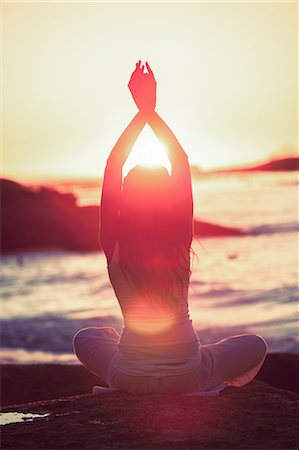 Silhouette of woman doing yoga during the sunset Stock Photo - Premium Royalty-Free, Code: 6109-06781824