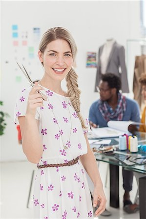 pretty draw - Attractive blonde designer holding scissors Stock Photo - Premium Royalty-Free, Code: 6109-06781958