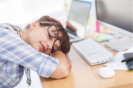 designer (female) - Overworked designer sleeping on her desk Stock Photo - Premium Royalty-Free, Code: 6109-06781962