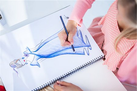 pretty draw - Fashion designer drawing clothes while she is sat at her desk Stock Photo - Premium Royalty-Free, Code: 6109-06781988