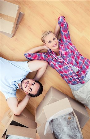 Couple lying on the wooden floor Stock Photo - Premium Royalty-Free, Code: 6109-06781994