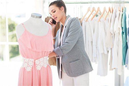 Attractive fashion designer on the phone Stock Photo - Premium Royalty-Free, Code: 6109-06781910