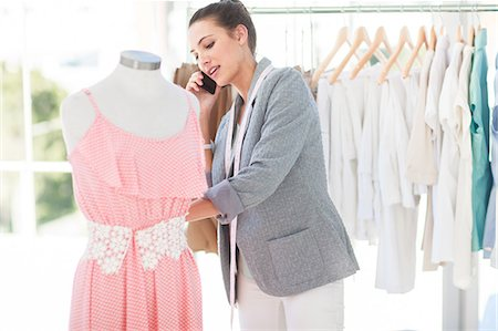 Attractive fashion designer on the phone Stock Photo - Premium Royalty-Free, Code: 6109-06781910
