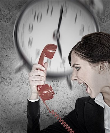 phone cord - Businesswoman under pressure with deadline shouting down the phone Stock Photo - Premium Royalty-Free, Code: 6109-07496961