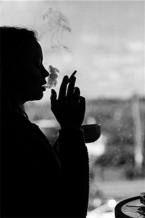 silhouette black and white - Silhouette of an attractive woman smoking cigarette in black and white Stock Photo - Premium Royalty-Free, Code: 6109-07496972