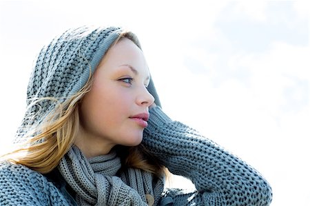 pretty - Pretty young woman wearing a scarf and looking away Stock Photo - Premium Royalty-Free, Code: 6109-07496990