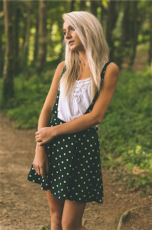 polka dot - Thoughtful gorgeous blonde standing on forest track in the woods Stock Photo - Premium Royalty-Free, Code: 6109-07497083