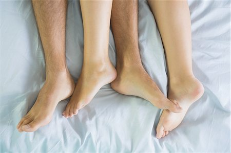 Peaceful couple cuddling in their bed in the bedroom Stock Photo - Premium Royalty-Free, Code: 6109-07497306