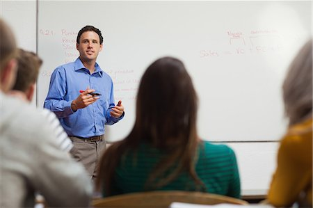 Casual students looking at whiteboard in classroom in a college Stock Photo - Premium Royalty-Free, Code: 6109-07497547
