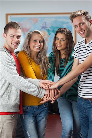 friendship - Cheerful casual students holding hands together in hallway in a college Stock Photo - Premium Royalty-Free, Code: 6109-07497566