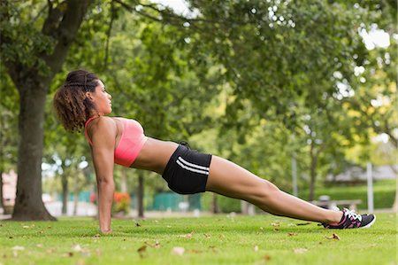 Full length side view of a toned young woman doing stretching exercise in the park Stock Photo - Premium Royalty-Free, Code: 6109-07498023