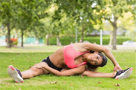 Full length of a toned and flexible woman doing stretching exercise in the park Stock Photo - Premium Royalty-Free, Code: 6109-07498028