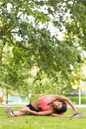 slim - Full length of a toned and flexible woman doing stretching exercise in the park Stock Photo - Premium Royalty-Free, Code: 6109-07498029