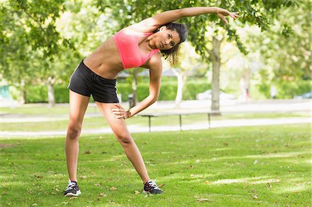 Full length of a toned and flexible woman doing stretching exercise in the park Stock Photo - Premium Royalty-Free, Code: 6109-07498034