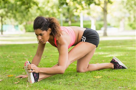 Full length of a toned and flexible woman doing stretching exercise in the park Stock Photo - Premium Royalty-Free, Code: 6109-07498036