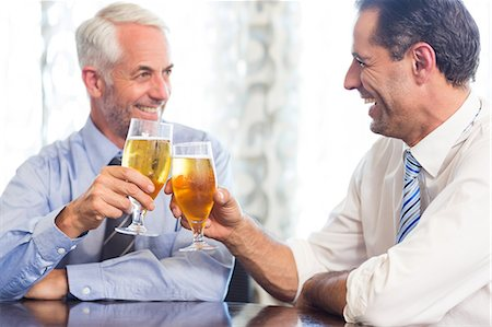 Business colleagues toasting beer glasses Stock Photo - Premium Royalty-Free, Code: 6109-07600853