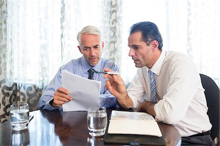 staff - Businessmen doing paperwork at office desk Stock Photo - Premium Royalty-Free, Code: 6109-07600851